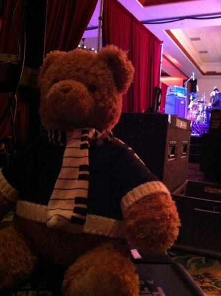Teddy bear sitting on a bass drum.