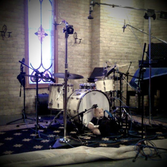Radio King drums in a large studio.